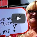 A thumbnail taken from the Austerity Uncovered video - showing a woman holding up a sign saying, 'Leave my little bedroom alone', in reaction to the bedroom tax.